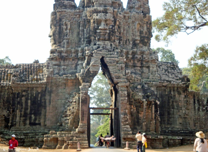 AngkorThomGate_pig_moped_cambodia