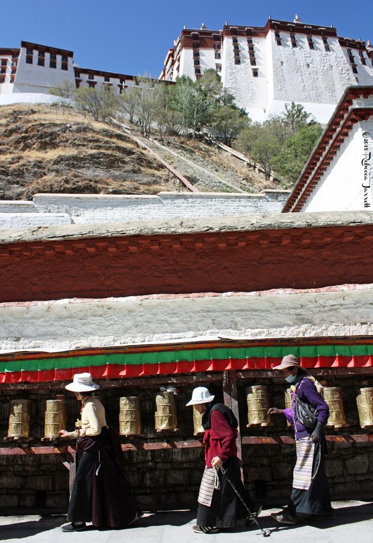 Pilgrims_PrayerWheelsonwaytoPotalaPalace_LhasaTibet_thepersephonepersepective_travelblog